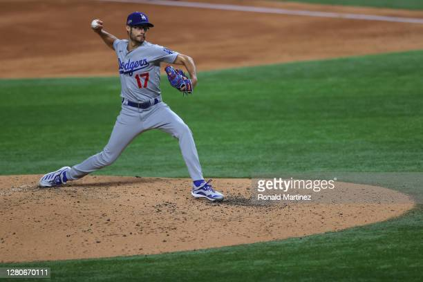 Joe Kelly of the Los Angeles Dodgers delivers the pitch against the Atlanta Braves during the third inning in Game Five of the National League...