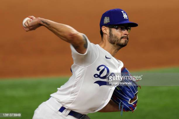 Joe Kelly of the Los Angeles Dodgers delivers the pitch against the Tampa Bay Rays during the ninth inning in Game One of the 2020 MLB World Series...