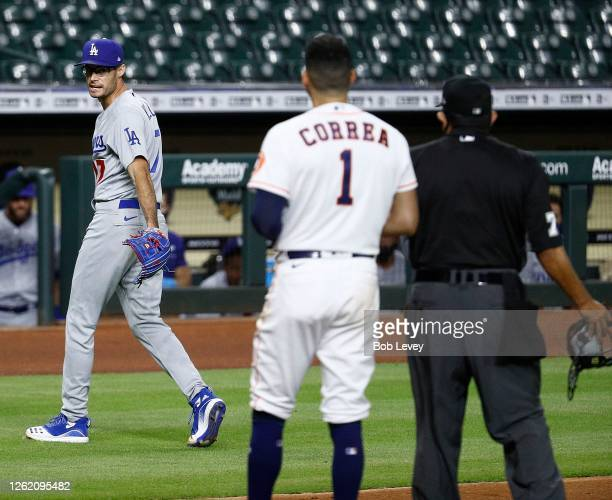 Joe Kelly of the Los Angeles Dodgers has a word with Carlos Correa of the Houston Astros as he walks off the mound after a series of high inside...
