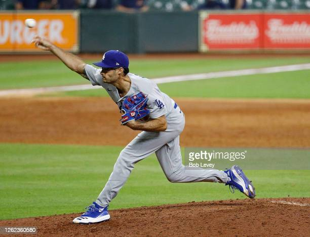 Joe Kelly of the Los Angeles Dodgers pitches against the Houston Astros in the sixth inning at Minute Maid Park on July 28, 2020 in Houston, Texas.