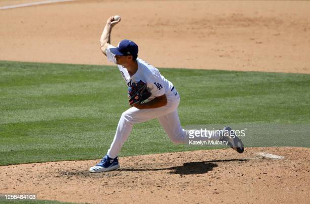 Joe Kelly of the Los Angeles Dodgers pitches against the San Francisco Giants during the sixth inning at Dodger Stadium on July 25, 2020 in Los...