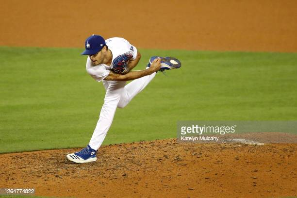 Joe Kelly of the Los Angeles Dodgers pitches against the San Francisco Giants during the ninth inning at Dodger Stadium on August 08, 2020 in Los...