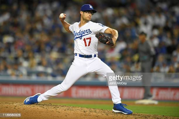 Joe Kelly of the Los Angeles Dodgers pitches to the Arizona Diamondbacks in the seventh inning at Dodger Stadium on March 29 2019 in Los Angeles...