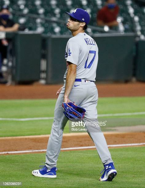 Joe Kelly of the Los Angeles Dodgers reacts after a series of high inside pitches to Carlos Correa of the Houston Astros in the sixth inning at...