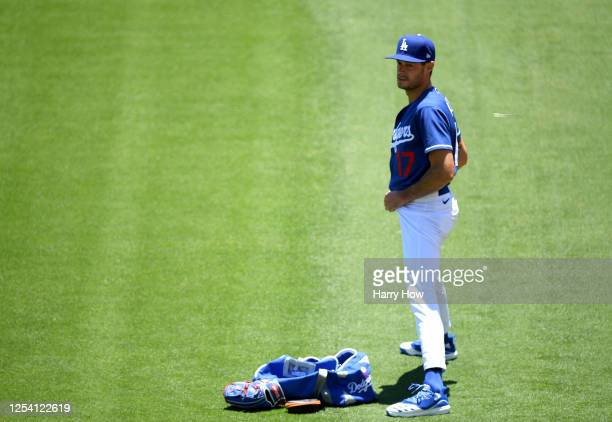 Joe Kelly of the Los Angeles Dodgers stretches at a summer workout in preparation for a shortened MLB season during the coronavirus pandemic at...