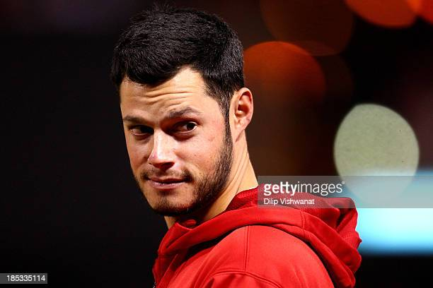 Joe Kelly of the St Louis Cardinals stands on the field across from Scott Van Slyke of the Los Angeles Dodgers before the start of Game Six of the...