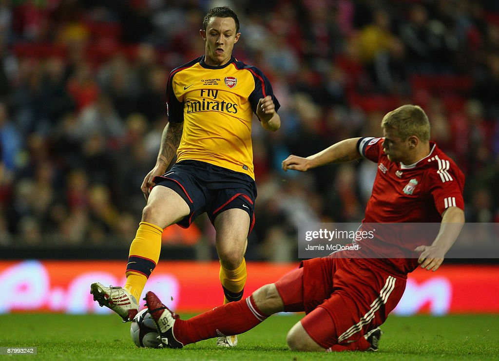 Joe Kennedy of Liverpool tackles Rhys Murphy of Arsenal during the second leg of the FA Youth Cup final sponsored by E.ON, between Liverpool and Arsenal at Anfield on May 26, 2009 in Liverpool, England.