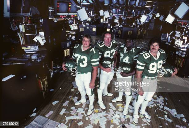 Joe Klecko Marty Lyons Abdul Salaam and Mark Gastineau of the New York Jets also known as The Sack Exchange pose of the floor of the New York Stock...