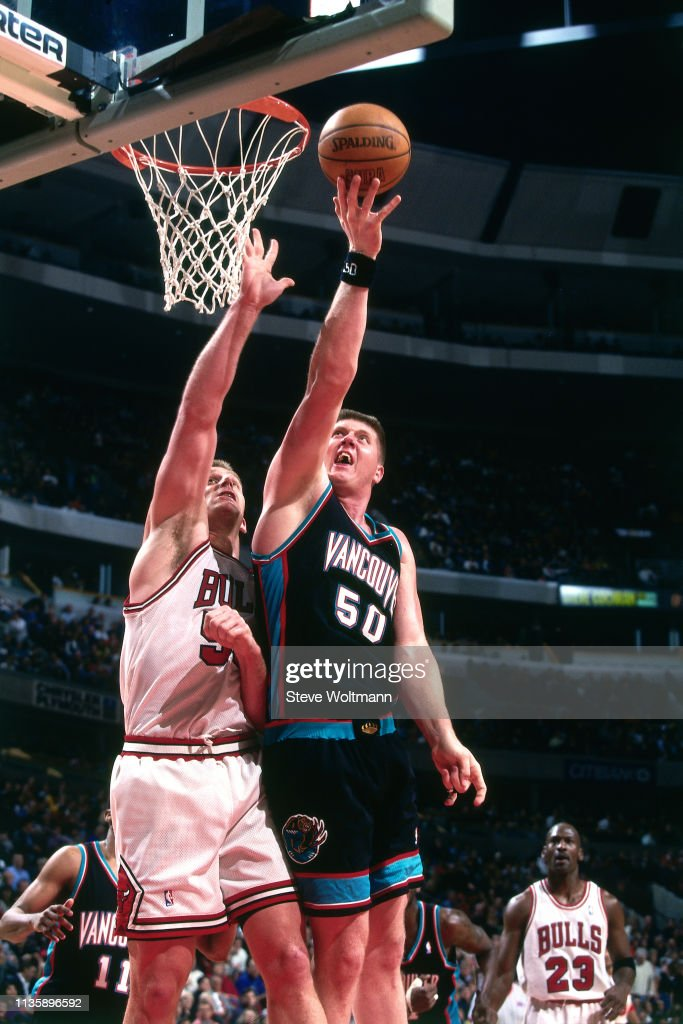 Joe Kleine of the Chicago Bulls contests the shot by Bryant