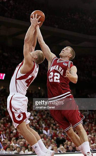 Joe Krabbenhoft of the Wisconsin Badgers and Lance Stemler of the Indiana Hoosiers battle for a rebound at the Kohl Center January 31 2008 in Madison...