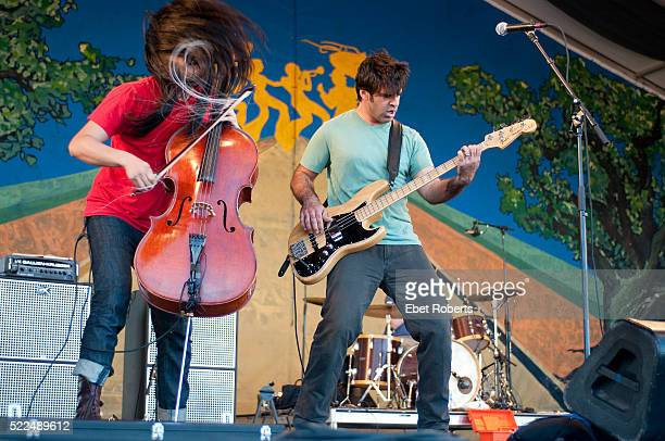 Joe Kwon and Bob Crawford of The Avett Brothers performing at the New Orleans Jazz and Heritage Festival in New Orleans Louisiana on April 29 2011
