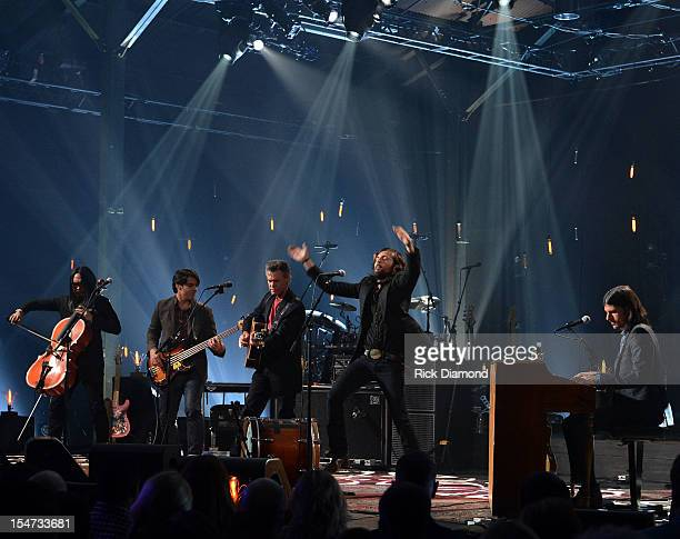 Joe Kwon Avett Brothers Bob Crawford Avett Brothers Randy Travis Scott Avett and Seth Avett perform during CMT Crossroads The Avett Brothers And...