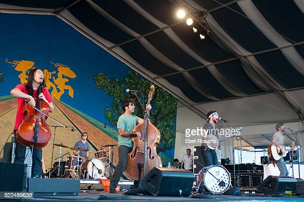 Joe Kwon Bob Crawford Scott Avett and Seth Avett of The Avett Brothers performing at the New Orleans Jazz and Heritage Festival in New Orleans...