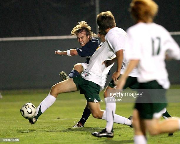 Joe Lapira slings a cross past the UAB defense during the Mike Berticelli Memorial Tournament at Alumni Field Notre Dame on Friday August 25 2006...