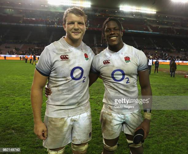 Joe Launchbury and Maro Itoje of England celebrate their victory during the third test match between South Africa and England at Newlands Stadium on...