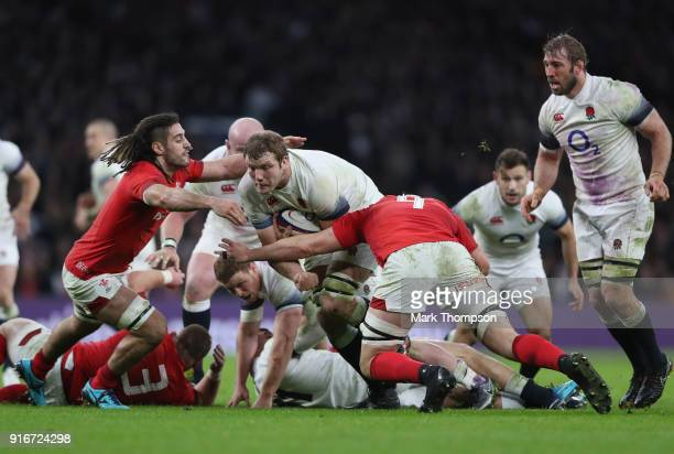 Joe Launchbury of England is tackled by Josh Navidi and Cory Hill of Wales during the NatWest Six Nations round two match between England and Wales...