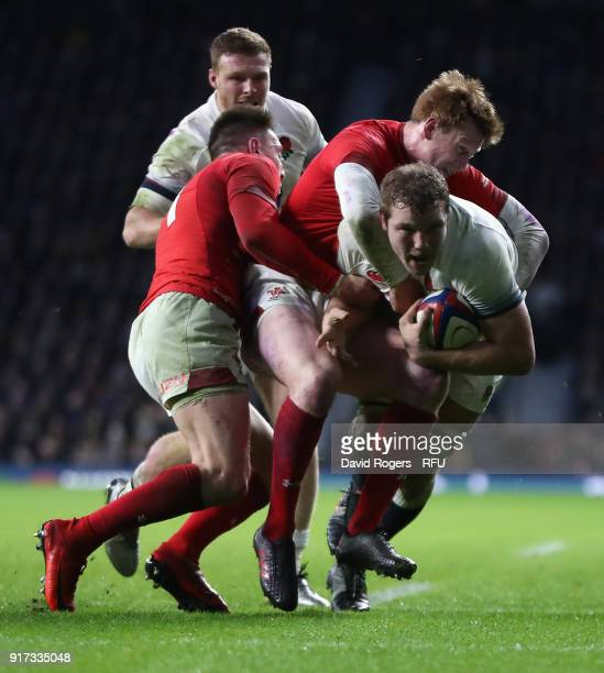 Joe Launchbury of England is tackled by Rhys Patchell and Josh Adams during the NatWest Six Nations match between England and Wales at Twickenham...