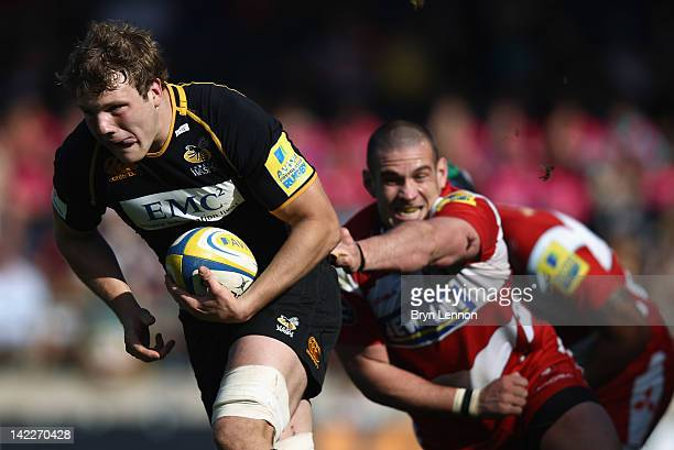 Joe Launchbury of London Wasps is tackled by Dan Murphy of Gloucester Rugby during the Aviva Premiership match between London Wasps and Gloucester at...