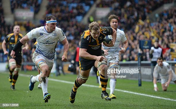 Joe Launchbury of Wasps charges for the goal line to score their second try during the European Rugby Champions Cup match between Wasps and Leinster...