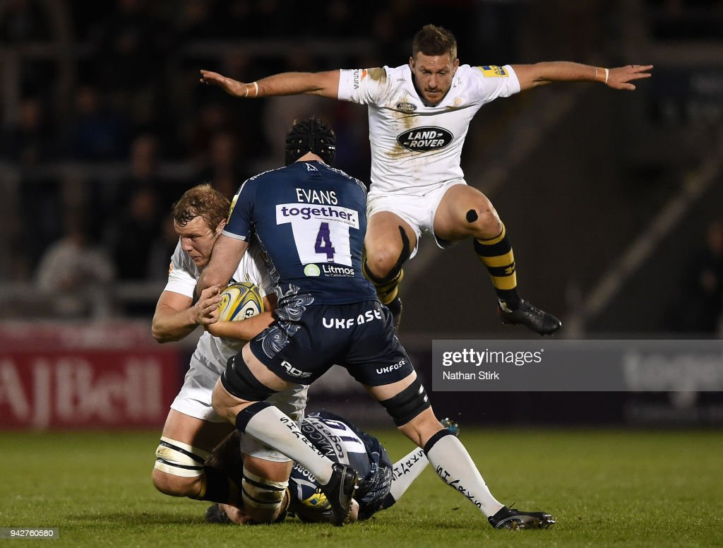 Joe Launchbury of Wasps is tackled by Bryn Evans of Sale during the Aviva Premiership match between Sale Sharks and Wasps at AJ Bell Stadium on April 6, 2018 in Salford, England.