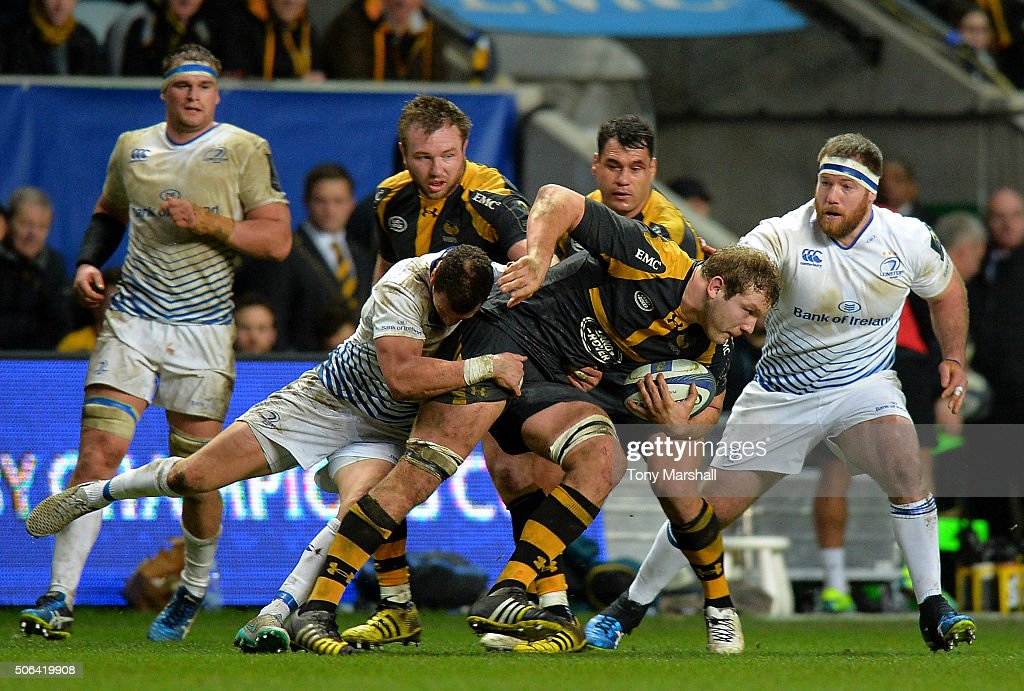 Joe Launchbury of Wasps is tackled by Rob Kearney of Leinster Rugby during the European Rugby Champions Cup match between Wasps and Leinster Rugby at Ricoh Arena on January 23, 2016 in Coventry, England.