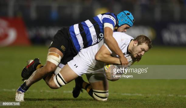 Joe Launchbury of Wasps is tackled by Zach Mercer during the Aviva Premiership match between Bath Rugby and Wasps at the Recreation Ground on...