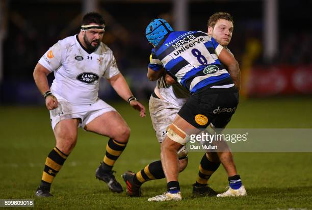 Joe Launchbury of Wasps is tackled by Zach Mercer of Bath during the Aviva Premiership match between Bath Rugby and Wasps at Recreation Ground on...