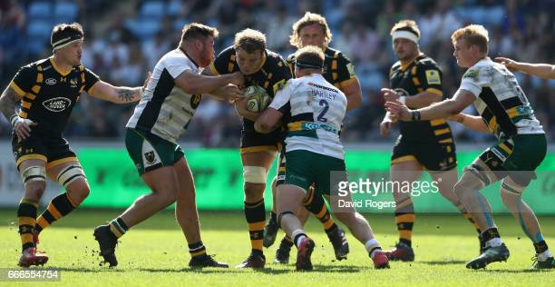 Joe Launchbury of Wasps is tackled during the Aviva Premiership match between Wasps and Northampton Saints at The Ricoh Arena on April 9 2017 in...