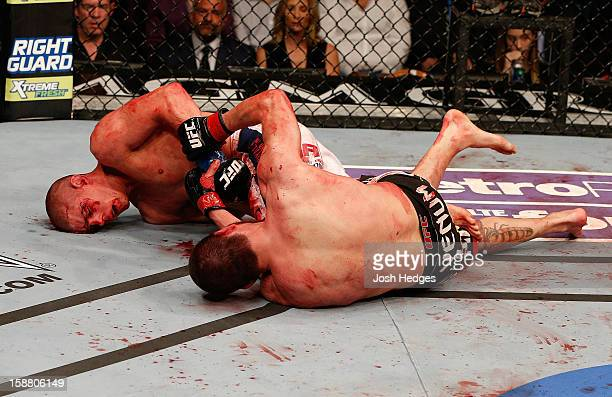 Joe Lauzon attempts to submit Jim Miller during their lightweight fight at UFC 155 on December 29, 2012 at MGM Grand Garden Arena in Las Vegas,...
