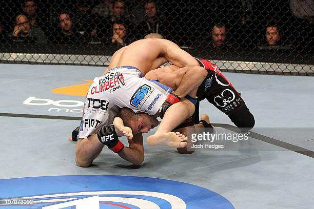 Joe Lauzon fights against George Sotiropoulos during their Lightweight bout part of UFC 123 at the Palace of Auburn Hills on November 20 2010 in...