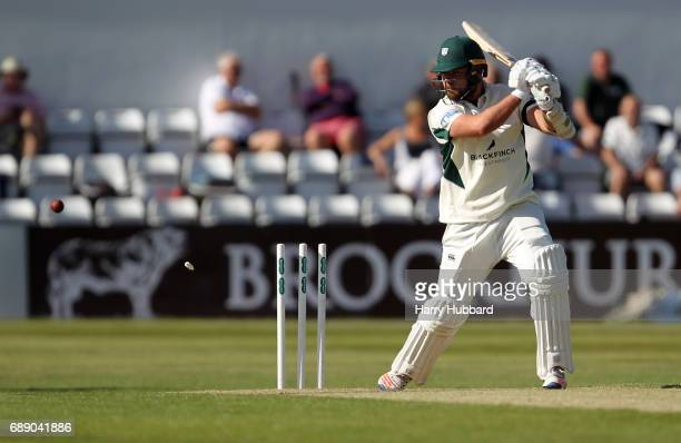 Joe Leach of Worcestershire is bowled by Ben Sanderson of Northamptonshire during the Specsavers County Championship division two match between...