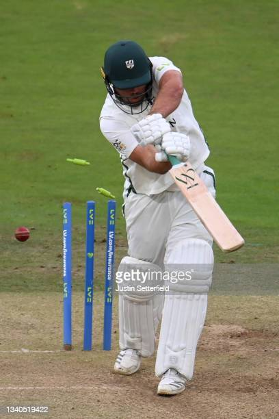 Joe Leach of Worcestershire is bowled by Ethan Bamber of Middlesex during the LV= Insurance County Championship match between Middlesex and...