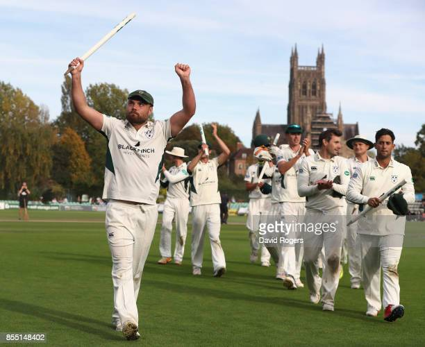Joe Leach the Worcestershire captain leads his team off the pitch after winning the Specsavers County Championship division two title after their...