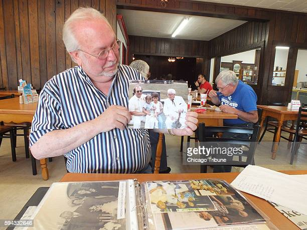Joe Ledington of Corbin Ky displays a 1980s photo of him with his uncle Colonel Harland Sanders who created his worldfamous Kentucky Fried Chicken in...