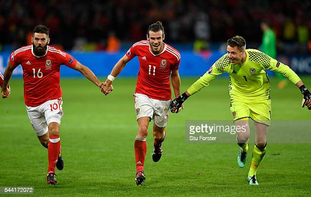 Joe Ledley Gareth Bale and Wayne Hennessey of Wales celebrate their team's 31 win after the UEFA EURO 2016 quarter final match between Wales and...