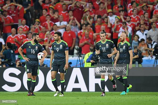 Joe Ledley, Hal Robson-Kanu], Gareth Bale and James Collins of Wales show their dejection after conceding a goal during the UEFA EURO 2016 semi final...