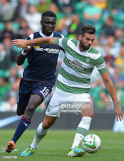 Joe Ledley of Celtic and Kevin Luckassen of Ross County in action during the Scottish Premier League game between Celtic and Ross County at Celtic...