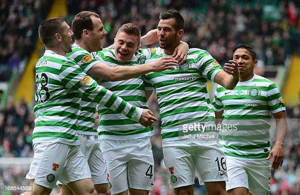 Joe Ledley of Celtic celebrates scoring the opening goal with his teammates during the Clydesdale Bank Scottish Premier League match between Celtic...
