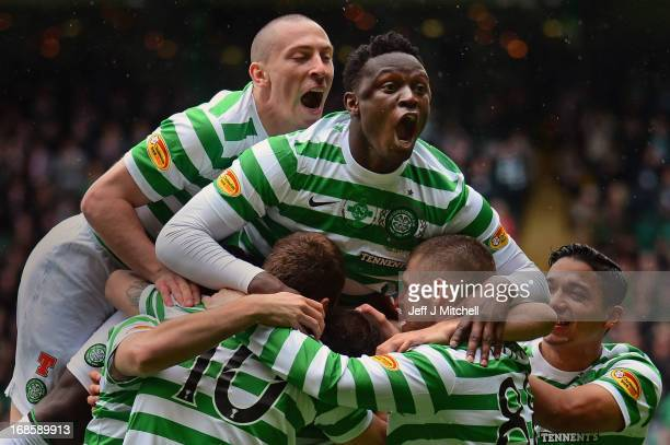 Joe Ledley of Celtic is joined by Scott Brown and Victor Wanyama as he celebrates after scoring the opening goal with his team-mates during the...