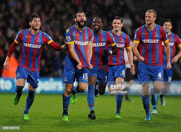 Joe Ledley of Crystal Palace celebrates after scoring the third goal during the Barclays Premier League match between Crystal Palace and Liverpool at...