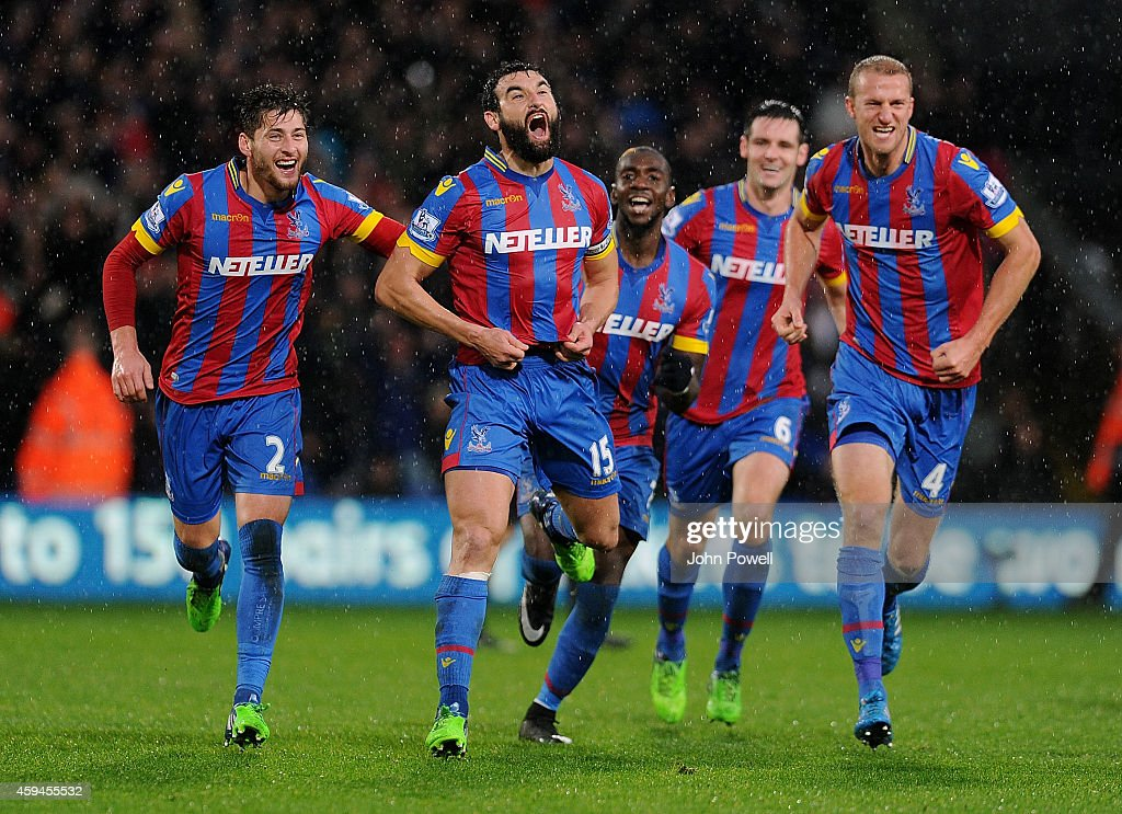 Joe Ledley of Crystal Palace celebrates after scoring the third goal during the Barclays Premier League match between Crystal Palace and Liverpool at Selhurst Park on November 23, 2014 in London, England.