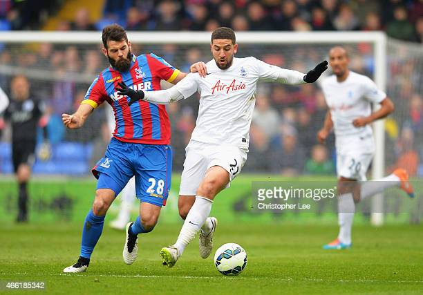 Joe Ledley of Crystal Palace challenges Adel Taarabt of QPR during the Barclays Premier League match between Crystal Palace and Queens Park Rangers...
