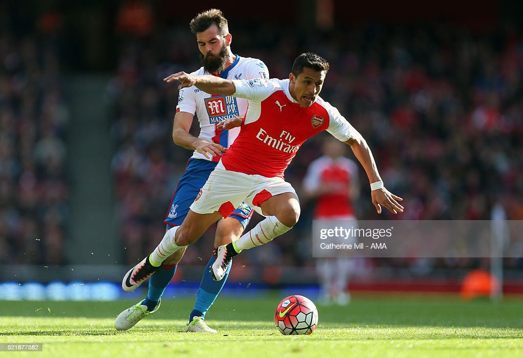 Joe Ledley of Crystal Palace fouls Alexis Sanchez of Arsenal during the Barclays Premier League match between Arsenal and Crystal Palace at the Emirates Stadium on April 17, 2016 in London, England.