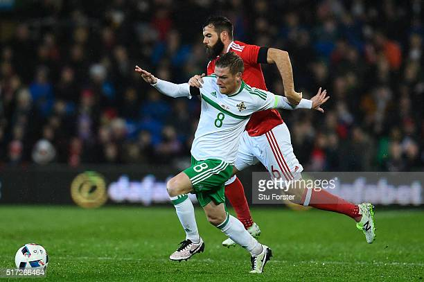 Joe Ledley of Wales and Steven Davis of Northern Ireland battle for the ball during the international friendly match between Wales and Northern...