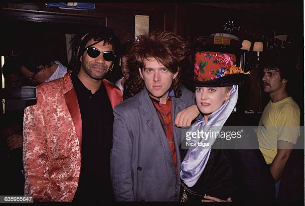 Joe Leeway Tom Bailey and Alannah Currie of the Thompson Twins visit the Hard Rock Cafe in New York