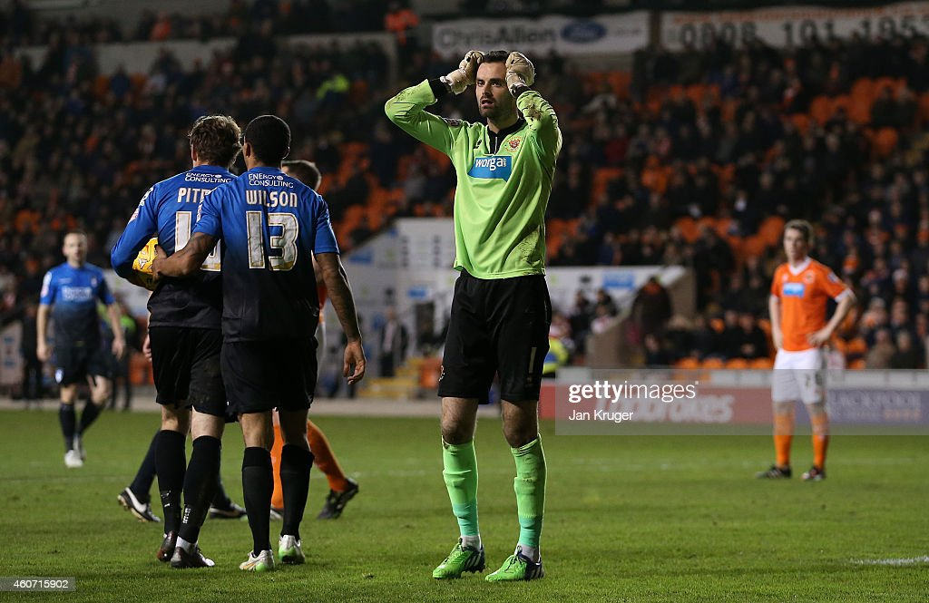 Joe Lewis, Goalkeeper of Blackpool looks on dejected after conceding six goals during the Sky Bet Championship match between Blackpool and Bournemouth at Bloomfield Road on December 20, 2014 in Blackpool, England.