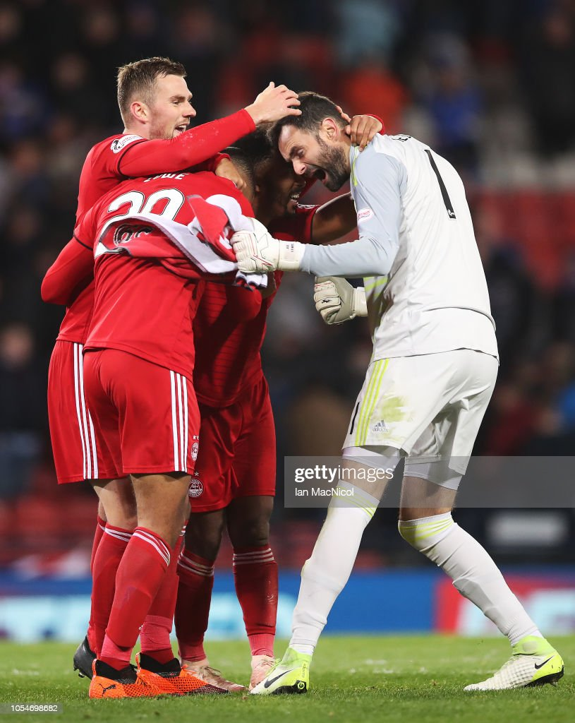 Joe Lewis, Max Lowe and Shay Logan of Aberdeen reacts at full time