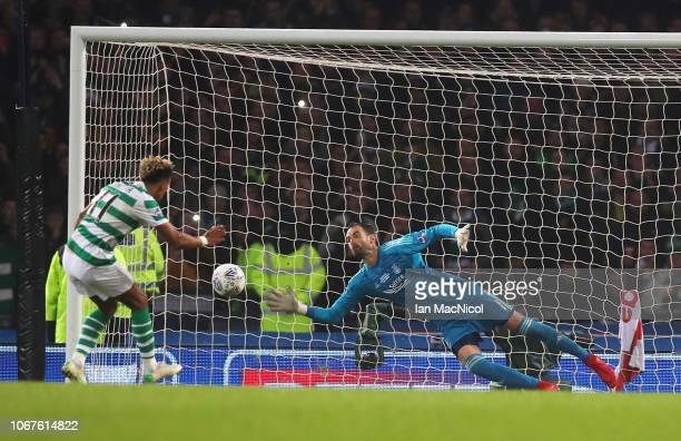 Joe Lewis of Aberdeen saves a penalty from Scott Sinclair of Celtic during the Betfred Cup Final between Celtic and Aberdeen at Hampden Park on...