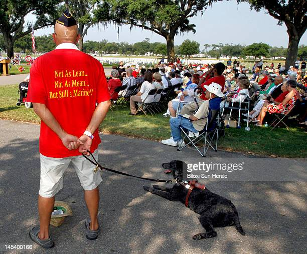 Joe Link and his seeingeye dog Gipper attend Memorial Day ceremony at National Cemetery in Biloxi Mississippi Monday May 28 2012