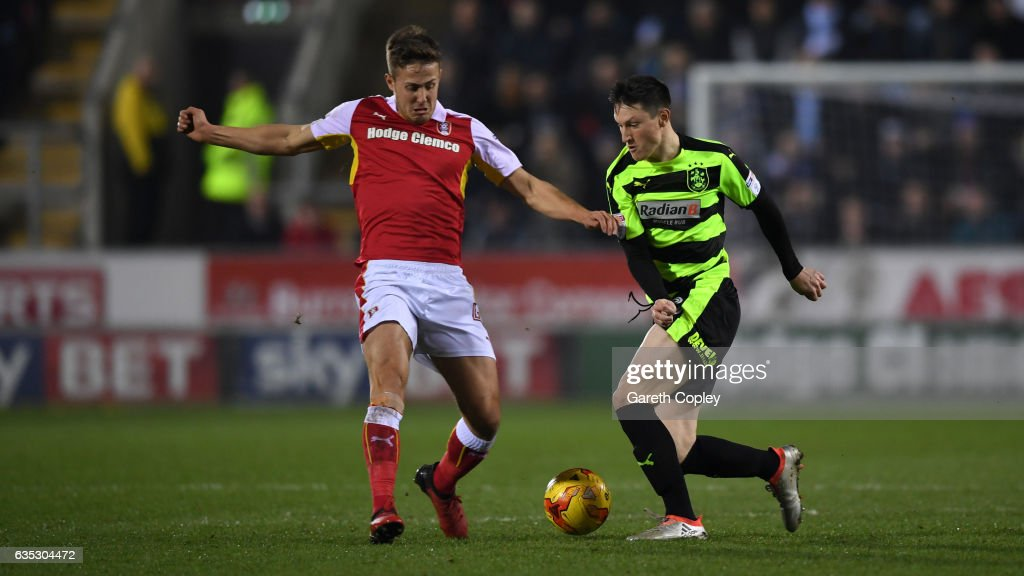 Joe Lolley of Huddersfield gets past Will Vaulks of Rotherham during the Sky Bet Championship match between Rotherham United and Huddersfield Town at The New York Stadium on February 14, 2017 in Rotherham, England.